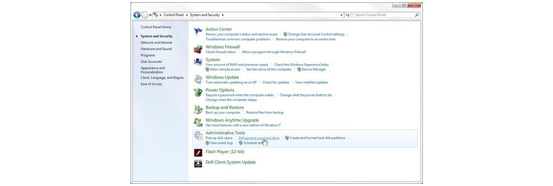 Colocar el puntero sobre el enlace de desfragmentar su unidad de disco duro en el sistema de Windows 7 y la ventana emergente de seguridad